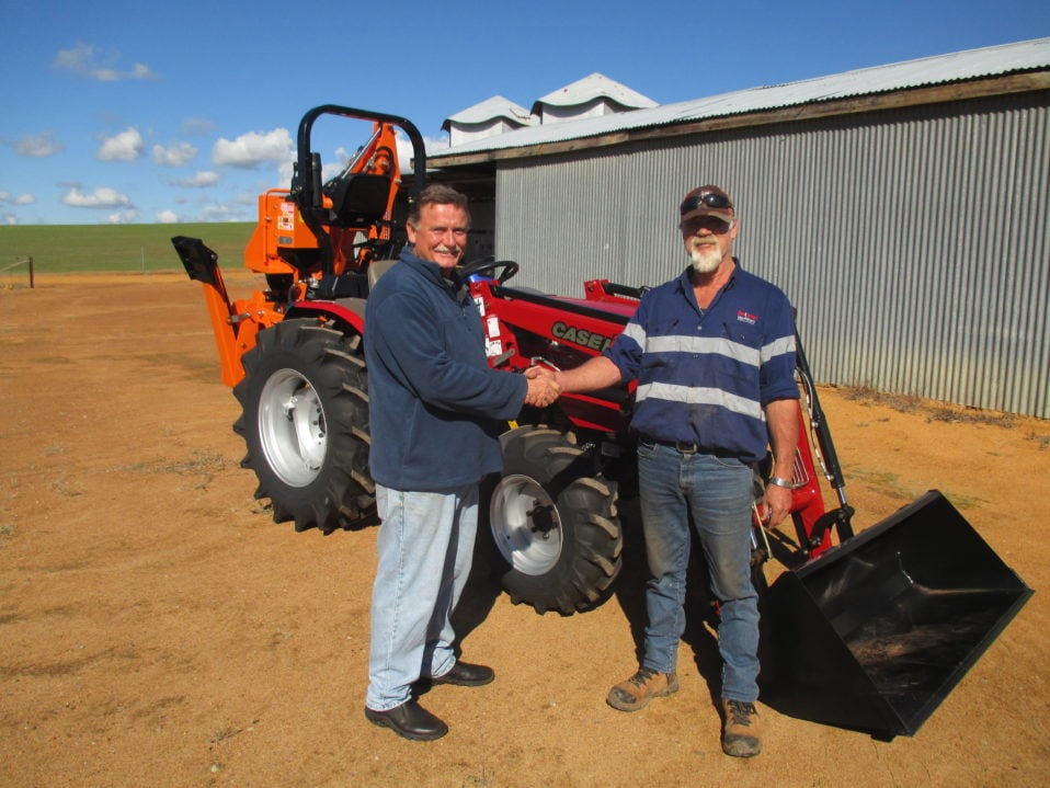 Boekeman's light-truck transport operator Marshall Reynolds unloading Nigel Lance from Bakers Hill New CASE IH Farmall 50B Compact 4wd Tractor & Loader plus a New BARRETT Backhoe Delivery