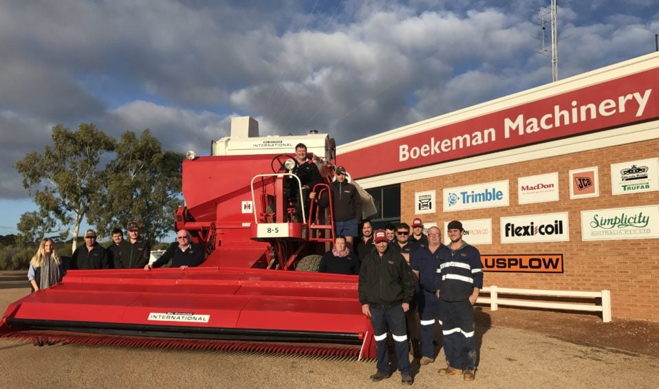 Employees of Boekeman Machinery along with the first machinery they sold
