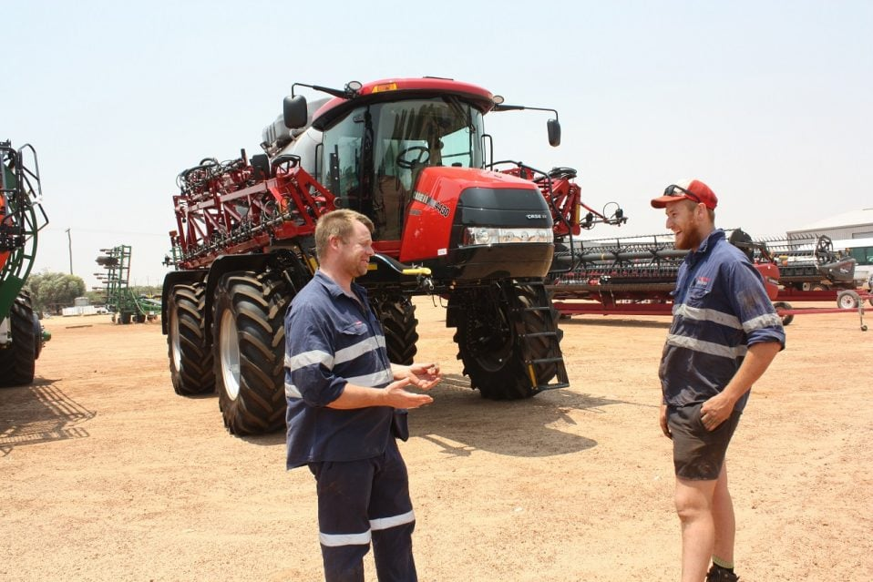 Wongan Hills Service Manager Clinton Barney having a conversation with his apprentice Mason Anspach and their Case IH Patriot self-propelled boomsprayer at the back