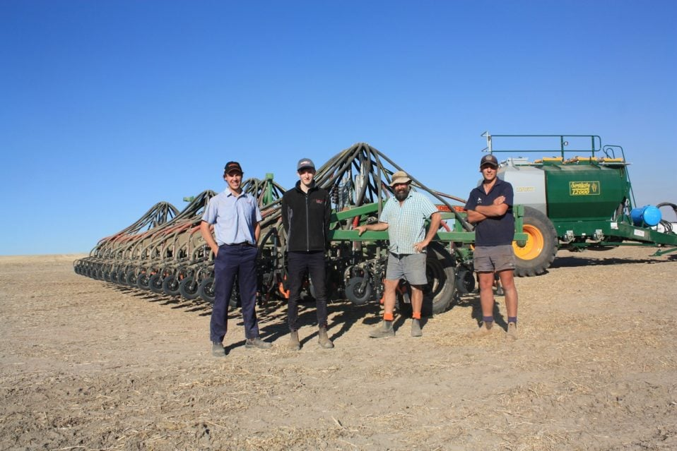 From left to right: Boekeman Machinery Wongan Hills salesmen Ben Boekeman, Ewan McLintock, Nathan Davey, and tractor driver Kane Corsiniwith with Mr Davey's new DBS precision seeder at the back