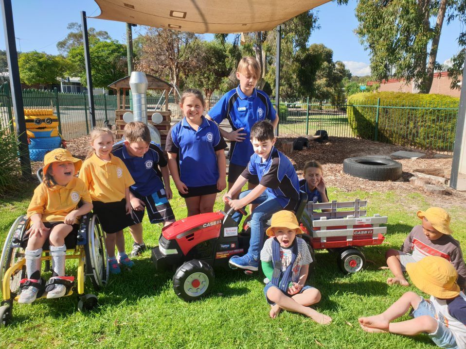 Kids from Wundowie Reed Childcare Centre playing with a CaseIH Tractor and Trailer toy