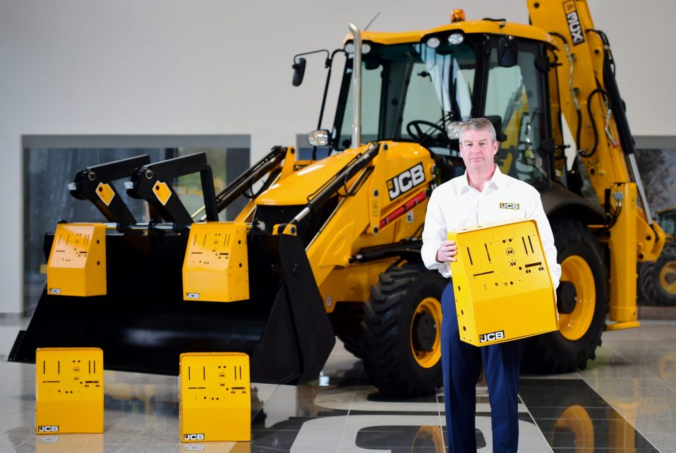 A JCB ventilator held by a man and 4 other ventilators in the background and a JCB truck