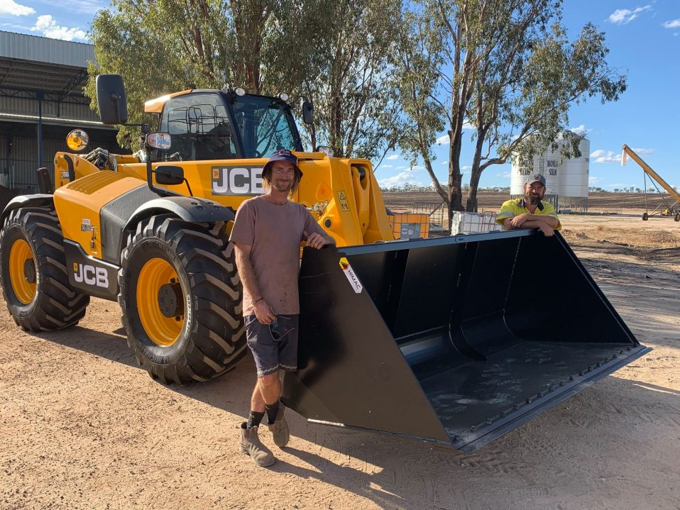 Gavin White from PE WHITE & SONS receiving their JCB 560-80 6T Lift 8m Reach with Himac 2m3 GP Bucket