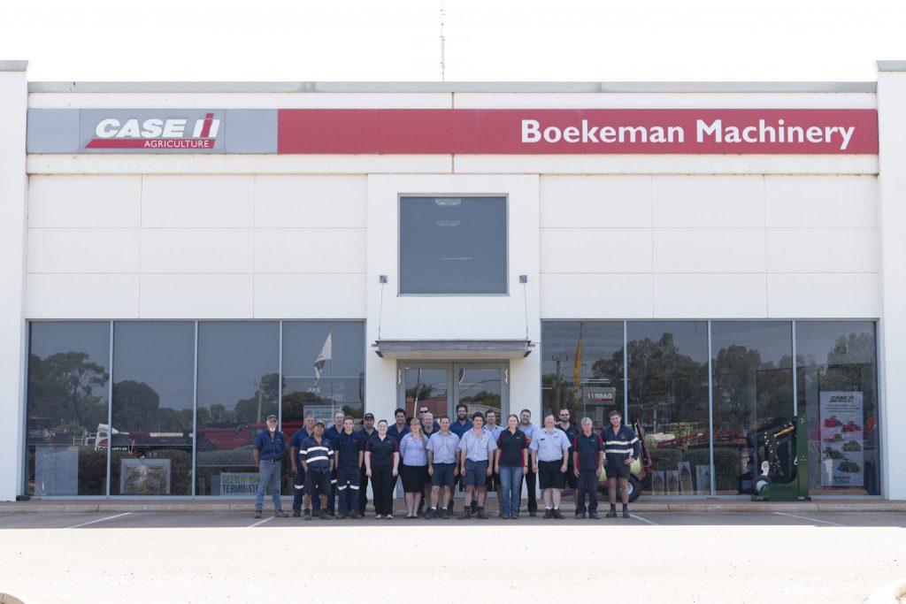 Boekeman Machinery employees in front of Boekeman Machinery store