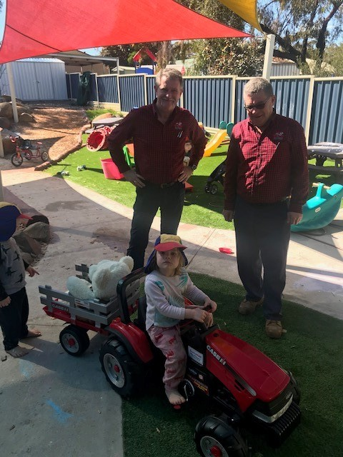 Steve Clarke (Parts Manager) & Kevin Dack (Group Parts Manager) delivered a New CASE IH Ride-On Tractor to Wongan Cubbyhouse with the kids playing with it