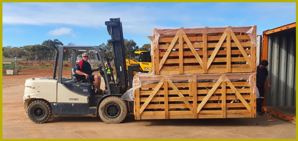 Forklift full of Pottinger franchise that's being transferred inside a container