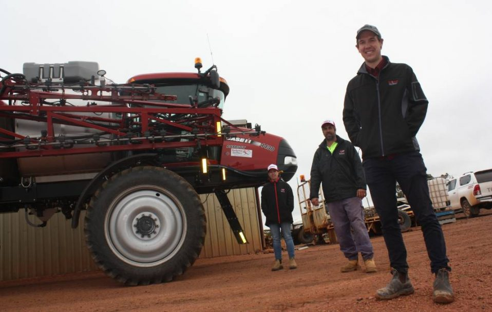 Wannamal farmers Renate (left) and Mark Stampalia with Boekeman Machinery, Wongan Hills, salesman Ben Boekeman checking out the Case IH Patriot 4430 self-propelled boomsprayer