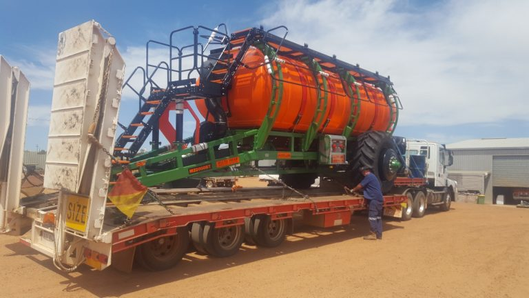 Huge truck transporting a large cylindrical container